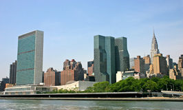 NYC Skyline with UN Building. NYC skyline showing  United Nations and Chrysler buildings taken from the Hudson River on a sunny day Royalty Free Stock Photos