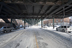NYC Snow Covered Streets. Aftermath of Blizzard underneath elevated train tracks Stock Images