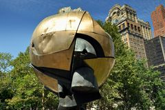 NYC: The Sphere in Battery Park. The Sphere by artist Fritz Koenig stood for three decades in the Plaza at the World Trade Center and was damaged during the 9-11 royalty free stock photos