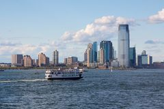 NYC Statue of Liberty Ferry before Jersey City Skyline Royalty Free Stock Photo