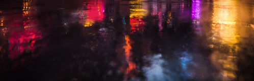 NYC streets after rain with reflections on wet asphalt Royalty Free Stock Photography