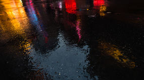 NYC streets after rain with reflections on wet asphalt Royalty Free Stock Photos
