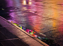 NYC streets after rain with reflections on wet asphalt Stock Photo