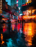 NYC streets after rain with reflections on wet asphalt. NEW YORK, USA - Apr 30, 2016: Lights and shadows of New York City. NYC streets after rain with Royalty Free Stock Image