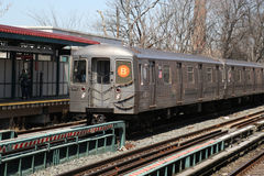 NYC Subway B Train arrives at Avenue M Station in Brooklyn. BROOKLYN, NEW YORK - APRIL 11, 2017: NYC Subway B Train arrives at Avenue M Station in Brooklyn Stock Images