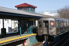 NYC Subway B Train arriving at Kings Highway Station in Brooklyn. BROOKLYN, NEW YORK - MARCH 12, 2015: NYC Subway B Train arriving at Kings Highway Station in Royalty Free Stock Photo
