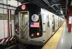NYC Subway L Train arrives at Eighth Avenue Station in Manhattan Stock Images