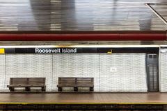 NYC subway station and bench Stock Image