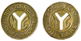 NYC Subway Tokens. Large Y cutout version of New York City subway token front and back circa 1970 to 1980 Stock Photography