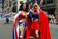 NYC: Supergirl and Wonder Woman at Gay Pride Parade. New York City - June 28, 2009: Wonder Woman and Super Girl at the 40th anniversary gay pride parade on 5th stock images