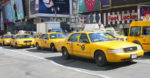 NYC Taxi. Yellow NYC taxi in traffic in Times Square,NY Royalty Free Stock Images