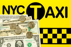 NYC Taxi fare concept. Dollar bills and coins on the black and yellow background Royalty Free Stock Photo