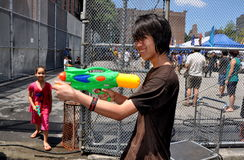 NYC: Teen with Water Gun at Burmese Festival Royalty Free Stock Images