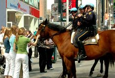 NYC:  Teenage Girls with NYPD on Horses Royalty Free Stock Photos