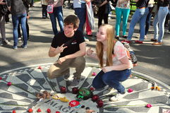 NYC: Teens at John Lennon Memorial Stock Photos