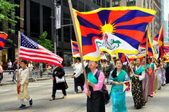 NYC: Tibetan Marchers at Immigrants Parade. Tibetan people carrying the American and Tibetan flags marching on NYC's Avenue of the Americas during the Royalty Free Stock Images
