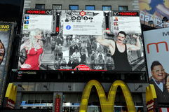 NYC: Times Square Animatronic Digital Billboard. A giant digital animatronic billboard for the Dunk Tank website built over a McDonald's restaurant features a Royalty Free Stock Photo