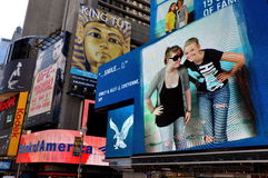 NYC: Times Square Billboards. Large advertising billboards cover the sides of buildings in Times Square at West 45th Street in New York City royalty free stock photography