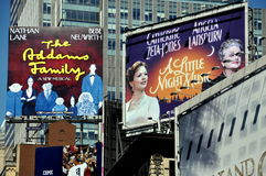 NYC: Times Square Billboards. Billboards advertising the Broadway musicals The Addams Family and A Little Night Music in New York City's dazzling Times Square royalty free stock photos