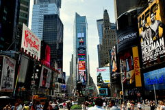 NYC: Times Square. Bustling Times Square filled with locals, tourists, and a plethora of advertising signs looking south to the renovated Times Tower (center) in royalty free stock photography