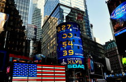 NYC:  Times Square and Nasdaq Sign. The NASDAQ electronic sign and other bright lights on Broadway in NYC's Times Square Stock Image