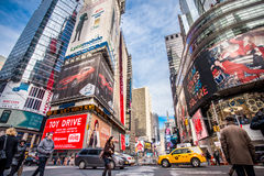 NYC Times Square. NEW YORK CITY - DEC 13:  Street view of Broadway at Times Square in New York City on Dec 13, 2013. Times Square is a busy entertainment Royalty Free Stock Photography