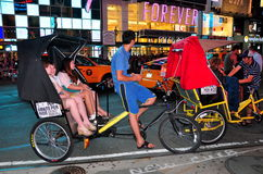 NYC: Times Square Tourists in Pedicabs Royalty Free Stock Photography
