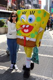 NYC: Tourist Posing with Sponge Bob Character Stock Photo