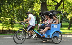 NYC: Tourists in Central Park Pedicabs Royalty Free Stock Photo