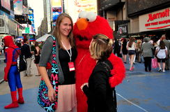 NYC: Tourists with Elmo in Times Square Royalty Free Stock Image