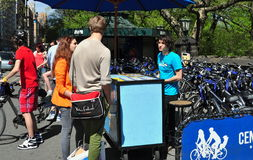 NYC: Tourists Renting Bicycle Stock Image