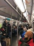 NYC Train Crowded People on Subway Train Rush Hour Commute stock photo