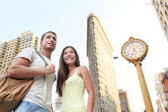 NYC travel tourists in New York City at Flatiron Stock Images