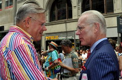 NYC: TV's Tim Gunn at Gay Pride Parade. New York State Senator and Tim Gunn, one of the hosts of TV's Project Runway confer on Fifth Avenue during the 2013 Gay Royalty Free Stock Photography