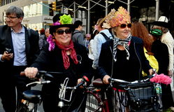 NYC: Two Women with Bicycles at Easter Parade Royalty Free Stock Image