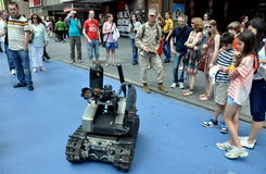 NYC: U.S. Army Robot Tank. A crowd of tourists watches as a miniature U. S. Army computerised robot tank performs a routine in Times Square during the city's Stock Photo
