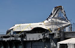 NYC:  U. S. Space Shuttle Enterprise. NASA's newly arrived United States Space Shuttle Enterprise sitting atop the deck of the Intrepid Air & Space Museum docked Stock Image