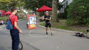 The 2013 NYC Unicycle Festival 68. Produced by Bindlestiff Family Variety Arts, Inc., the New York City Unicycle Festival brings together recreational riders Stock Photo