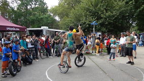 The 2013 NYC Unicycle Festival 60. Produced by Bindlestiff Family Variety Arts, Inc., the New York City Unicycle Festival brings together recreational riders Royalty Free Stock Photo
