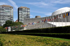 NYC:  The United Nations General Assembly Bldg. The United Nations General Assembly Building with the flags of its member nations on First Avenue at East 42nd Royalty Free Stock Photo