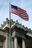NYC: US flag over historic building. U.S. flag flying over Metropolitan Museum of Art in New York City Royalty Free Stock Image