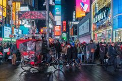 NYC/USA 31 DEZ 2017 - People walking in times square, new york by night stock photos