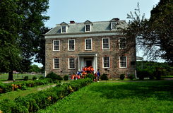 NYC:  1748 Van Cortlandt Manor House Museum. NYC (The Bronx):  South front of high Georgian 1748 Van Cortlandt Manor House built in dressed fieldstone with a Royalty Free Stock Images