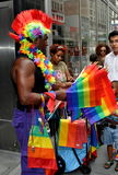 NYC: Vendor Selling Rainbow Flags at Gay Parade Royalty Free Stock Images