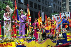 NYC: Vietnamese Riding on Parade Float Royalty Free Stock Image