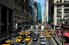 NYC: View of East 42nd Street. View from NYC's Park Avenue looking west along busy East 42nd Street filled with taxis, buses, trucks, and cars near Grand Central stock image