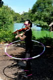 NYC: Violinist with Hula Hoop in Central Park Royalty Free Stock Photos