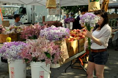 NYC:  Woman Buying Flowers at Farmers Market Royalty Free Stock Image
