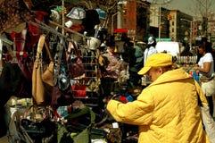 NYC: Woman Buying Handbags in Harlem Royalty Free Stock Photography