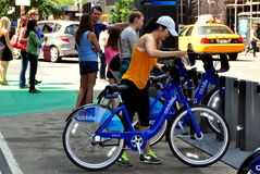NYC: Woman with Citibike at Docking Station Stock Photos